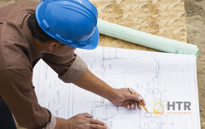 Contractor Working on Building Plans